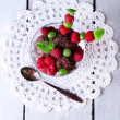 Chocolate ice cream with mint leaf and  ripe berries in glass bowl, on color wooden background — Stock Photo #49206507