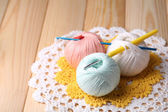 Colorful clews, napkin and crochet hook on wooden background — Stock Photo