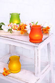 Bright icon-lamps with flowers on wooden ladder on light background — Stock fotografie