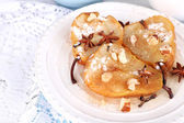 Baked pears with syrup on plate, on bright background — Stock Photo