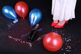 Legs with confetti, champagne and balloons — Stockfoto