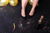 Legs with confetti, champagne and balloons — Foto de Stock