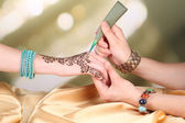 Process of applying Mehndi on hand — Stock Photo