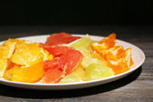 Sliced citrus fruits on plate — Stock Photo
