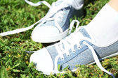Female legs in sneakers — Stock Photo