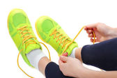 Young woman tying shoelace — Stock Photo