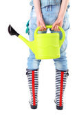Young woman in rubber boots holding watering can, isolated on white — Stock Photo