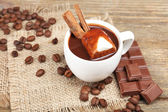 Cup of hot chocolate on table, close up — Stock Photo