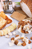 Homemade croutons on table in kitchen, close up — Stock Photo