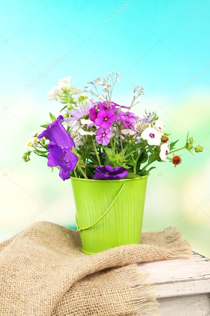 Цветы в декоративной вазе