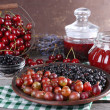Berries jam in glass jars on table, close-up — Stock Photo #49258625