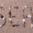 Word sea made from sea shells and stones on sand — Stock Photo #49259251
