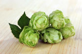 Fresh green hops, on wooden background — Stockfoto