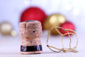 Champagne cork on champagne glasses background — Stock Photo
