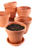 Clay flower pots and soil, isolated on white  — Stock Photo