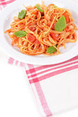 Pasta with tomato sauce on plate on table close-up — Stock Photo