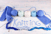 Yarns for knitting on wooden table close-up — Stock Photo