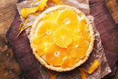 Homemade orange tart on wooden background — Stock Photo
