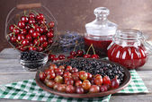 Berries jam in glass jars on table, close-up — Stock Photo