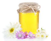 Jar full of delicious fresh honey and wild flowers, isolated on white — Stock Photo