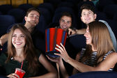 Young people watching movie in cinema — Stock Photo