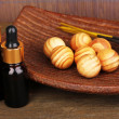 Aromatherapy setting on brown bamboo background — Stock Photo #49347357