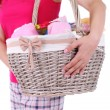 Woman holding laundry basket with clean clothes, towels and pins, isolated on white — Stock Photo #49348617
