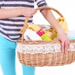 Woman holding laundry basket with clean clothes, towels and pins, isolated on white — Stock Photo #49348621