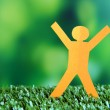 Paper people on green grass, close up — Stock Photo #49349251