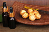 Aromatherapy setting on brown bamboo background — Stock Photo