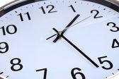 Round office clock close up — Stock Photo