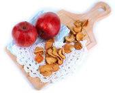 Dried apples and fresh apples,on cutting board isolated on white — Stock Photo