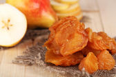 Dried pears on wooden background — Stock Photo
