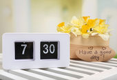 Alarm clock on table, on light background — Stock Photo