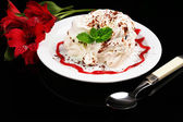 Tasty cake with cream, on black background — Stock Photo