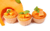 Tasty pumpkin muffins, isolated on white — Stock Photo