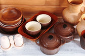 Different tableware on shelf, on wooden background — 图库照片