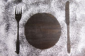 Imprint of cutlery  made of flour on table close-up — Stock Photo