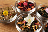 Assortment of dry tea on wooden table, close up — Stock Photo