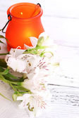Bright icon-lamp with flowers on wooden background — Stock Photo