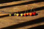 Sweet cherries on wooden table  — Stock Photo