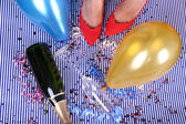 Legs with confetti, champagne and balloons on the floor — Stok fotoğraf