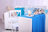 Festive table setting in interior — Stock Photo