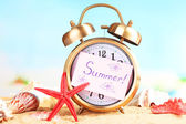 Summertime. Old clock on sand  — Stockfoto