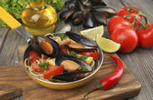 Traditional noodles with mussels on table, close up — Stock Photo