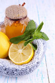Folk remedies for colds on wooden table — Stock Photo