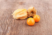 Physalis fruits on wooden background — Stock Photo