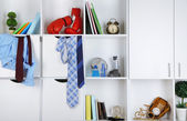 Beautiful white drawers and shelves with different home related objects. Male room concept — Stock Photo