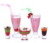 Glasses of tasty smoothies and milk shake, isolated on white — Stock Photo