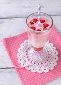 Glass of raspberry smoothie drink on wooden background — Stock Photo